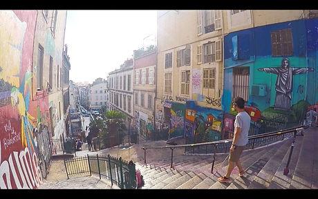Dan walking down stairs in Marseille, France