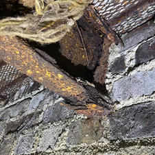 Corroded Structural Steel I-Beam in a Residential Basement