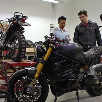 Ding Dong Dantes driving in his Ducati Monster.
