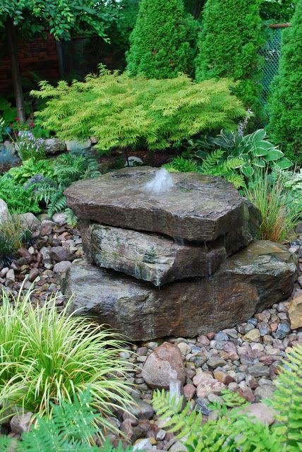 Drilled rock water feature