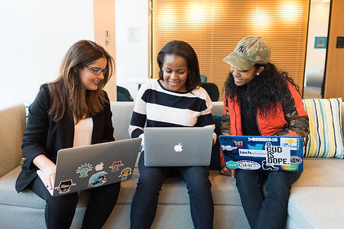 three-woman-in-front-of-laptop-computer-