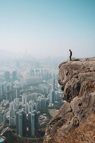 man-standing-on-cliff-3264736.jpg