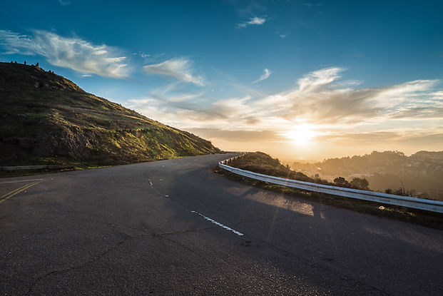 Winding road at sunset