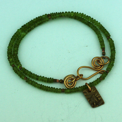 Faceted Peridot Necklace with Bronze Pendant