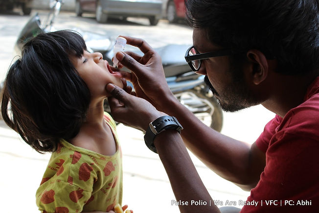 Volunteers administering Pulse Polio Drops