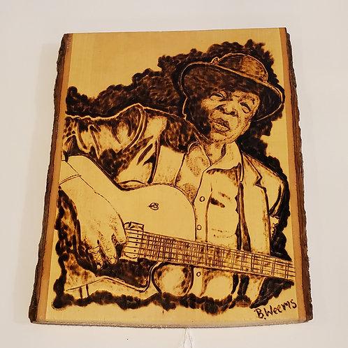 John Lee Hooker wood burning by Bryan Weems