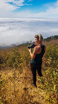 Hannah Unbound standing on a hillside wi