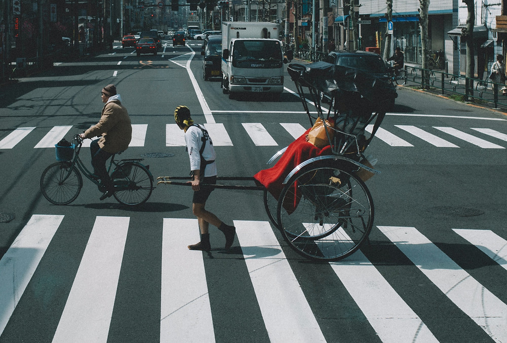 Man pulling a rickshaw