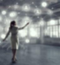 womaninfront of virtual grid.jpg