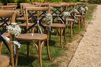 Rows of wooden chairs for guests standin