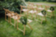 wooden chairs with a laurel wreath on a