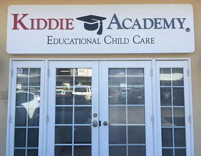 Front door and sign for Kiddie Academy Educational Child Care