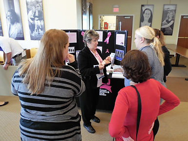 Advice about breast health is offered at Project Self-Sufficiency's Health Fair.