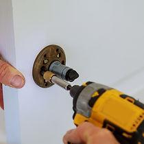 bigstock-Installation-Of-Door-Lock-Usin-