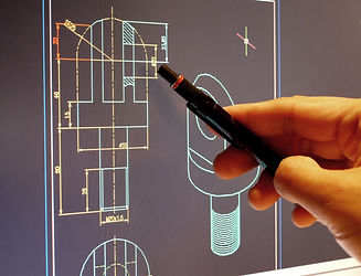 designer working on a cad blueprint .jpg
