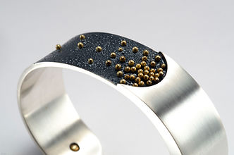 silver cuff with gold beads close up-383