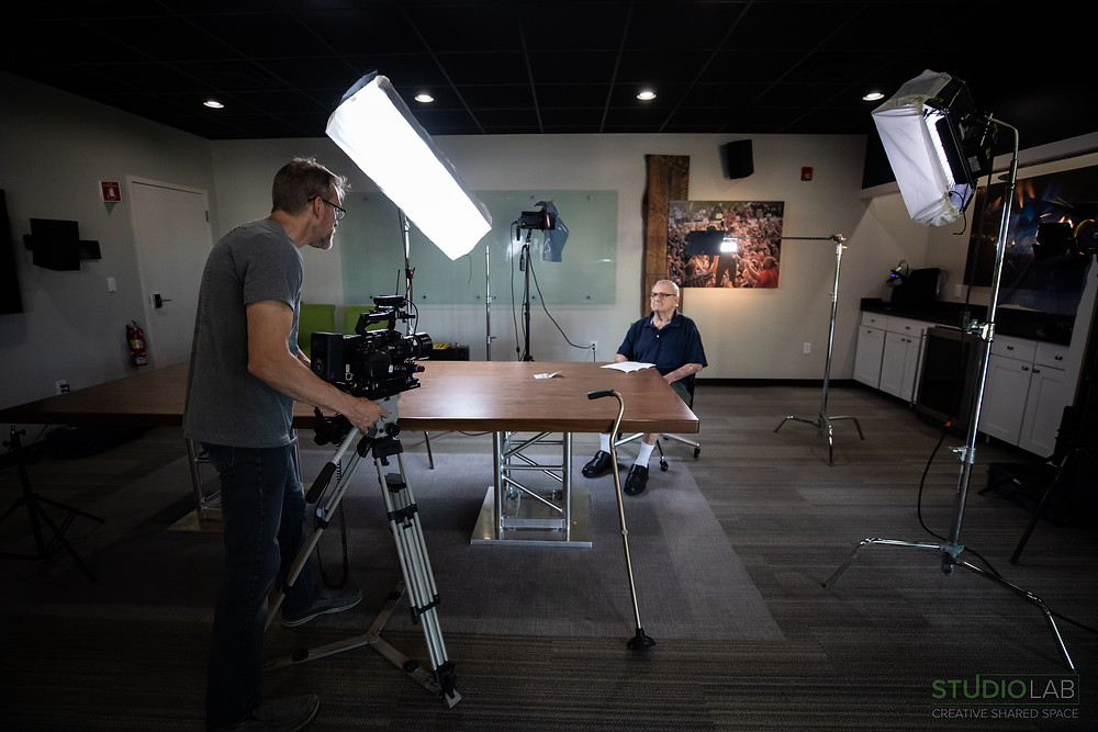 Conference room set up as video studio for comedy short