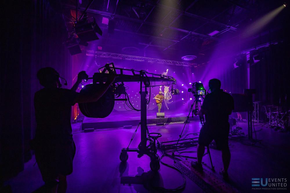 jib operator in studio using creative lighting