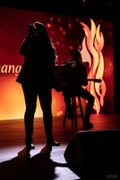 Creative shot of artist performing for Girls Inc virtual gala