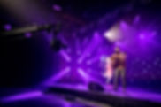 Artist performing on virtual stage for online gala with camera jib and wireless microphone