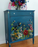 Turquoise dresser with midnight garden