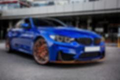 blue-sport-sedan-parked-yard_114579-5078