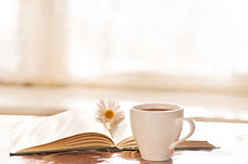 flower on the book, the Cup of black cof