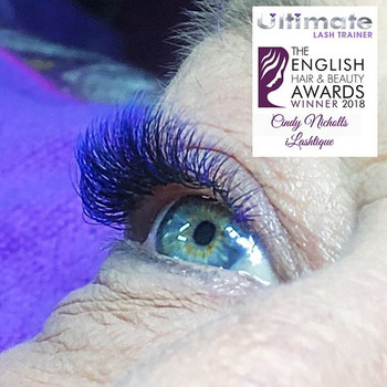 Blue & purple infill over black lashes.