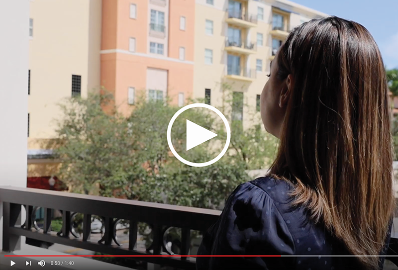 Photo of Woman's Profile Looking at a Building. Click to access video.