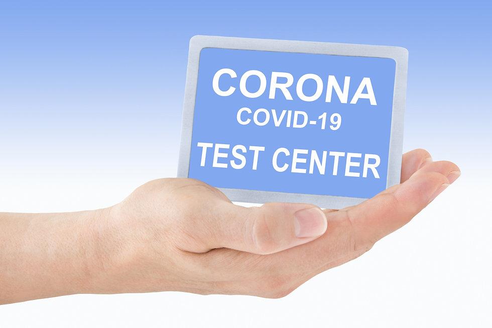 Corona Covid-19 Test Center and hand.jpg