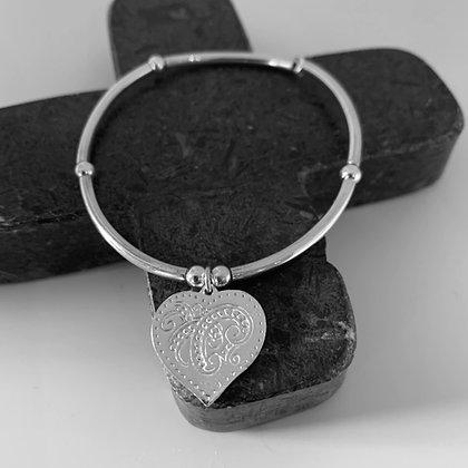 Bar bracelet with swirl heart
