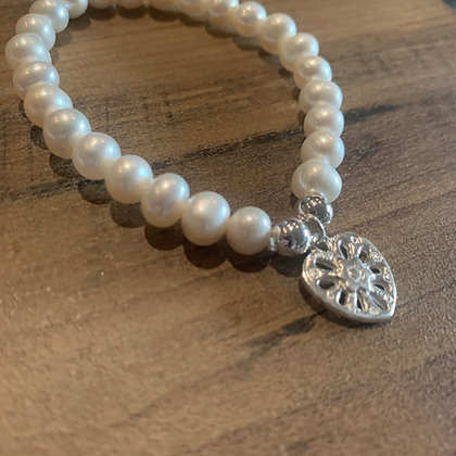 Pearl bracelet with cut out heart