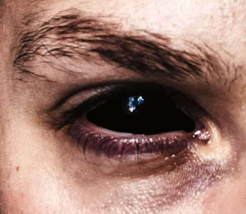 Closeup of a Hexxer man's eye