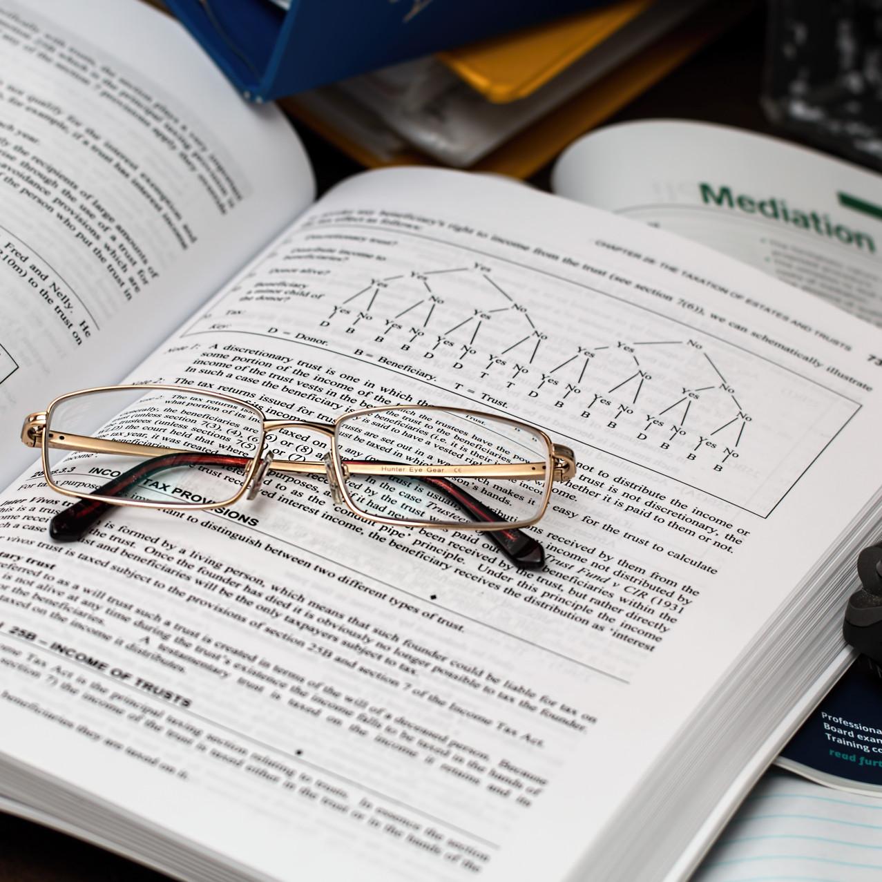 eyeglasses on open workbook
