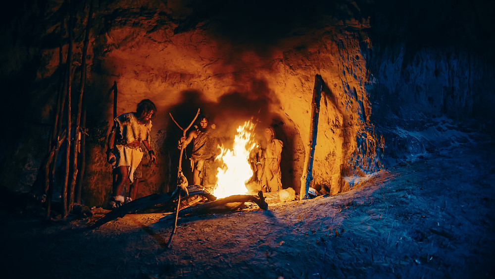 tribe of hunter-gatherers around a fire