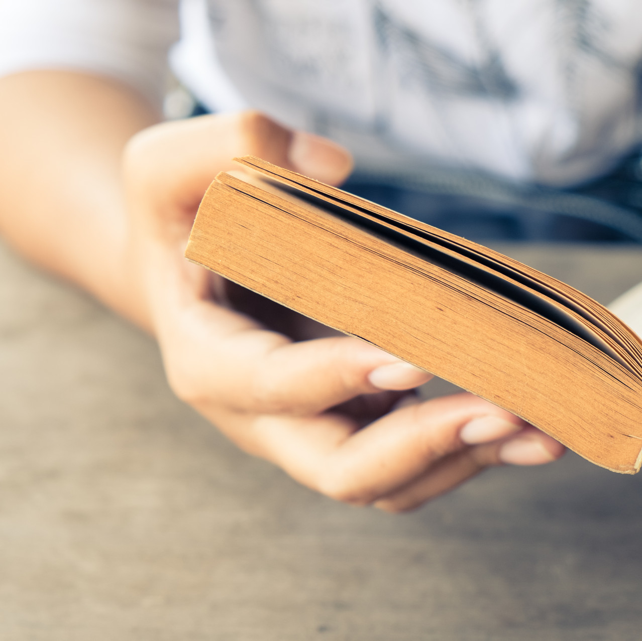 closeup of woman's hand holding book