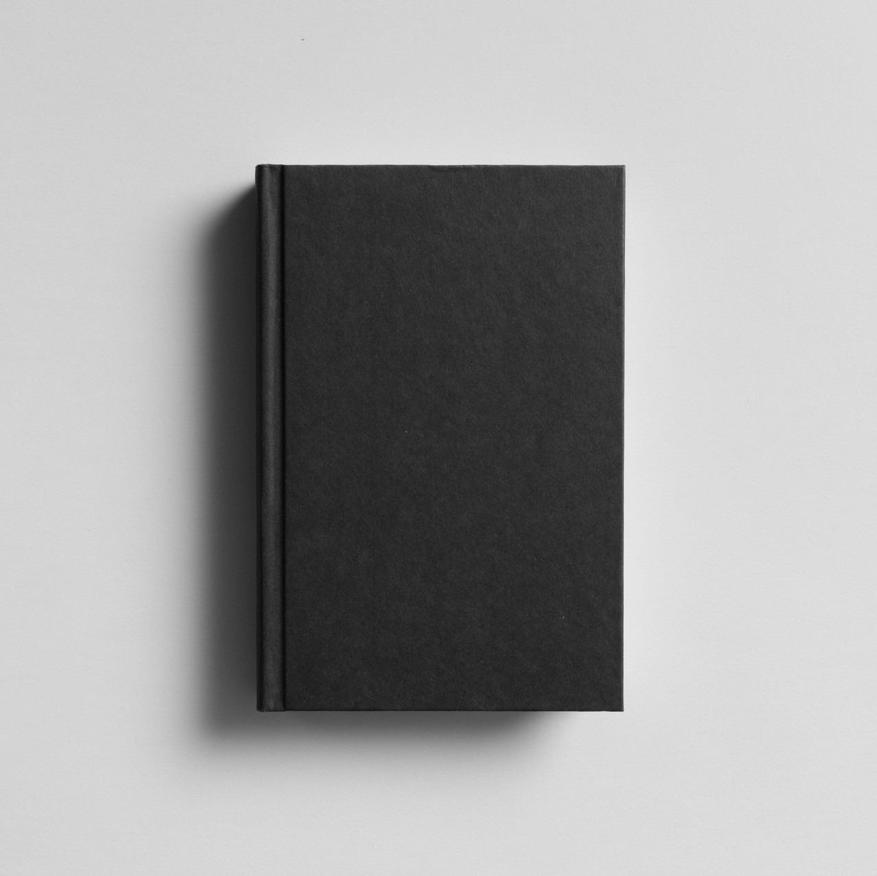 black hardcover book (no jacket)