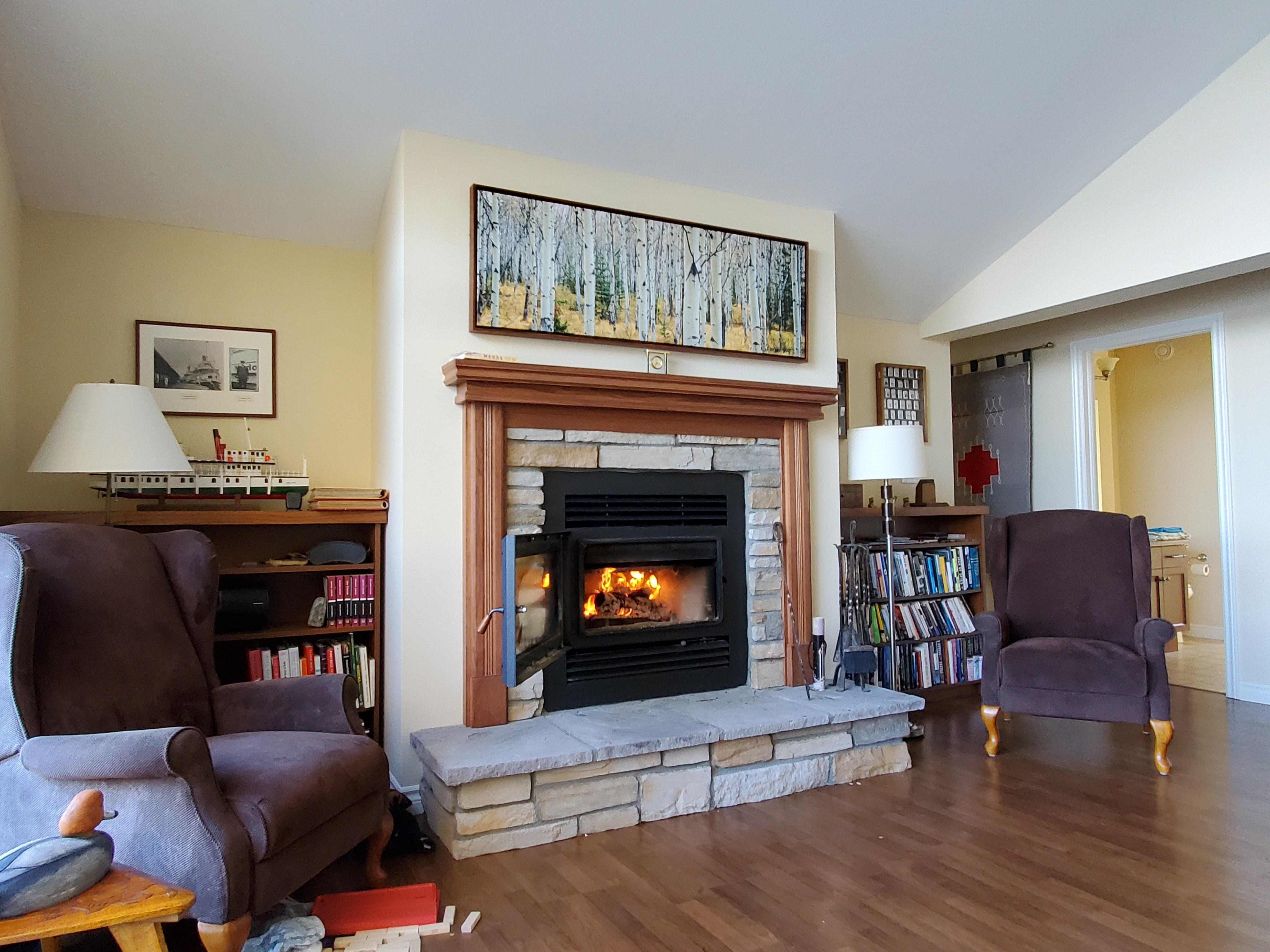 modern woodburning fireplace in great ro