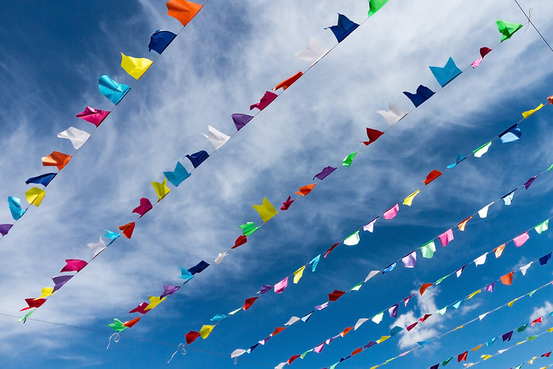 small-cute-colorful-flags-on-rope-hanging-outside-for-holiday-with-bright-blue-sky-white-c