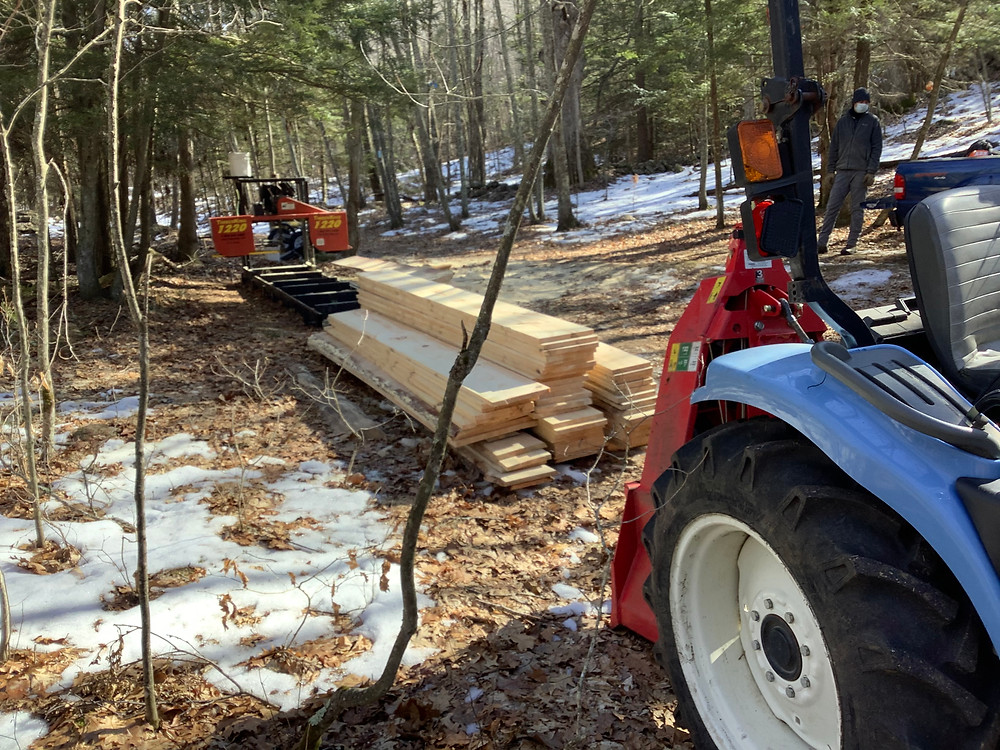 The tractor bring the sawmill into the woods, and hauls it out again with a nice pile of boards when the project is done.