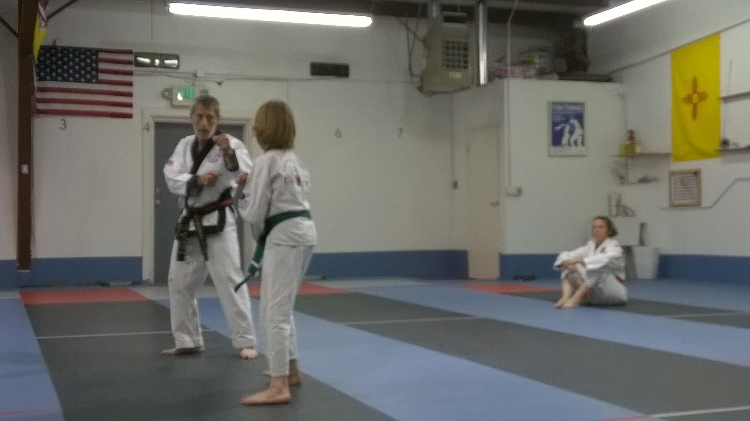 Youth receiving sparring instruction