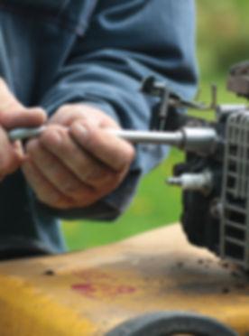 repairing lawn mower engine.jpg