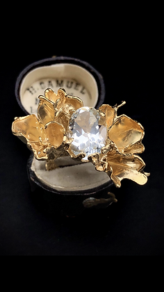 Gold petal ring with white topaz