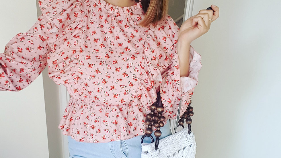 Pink blouse with flowers print