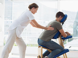 Side view of man receiving back massage