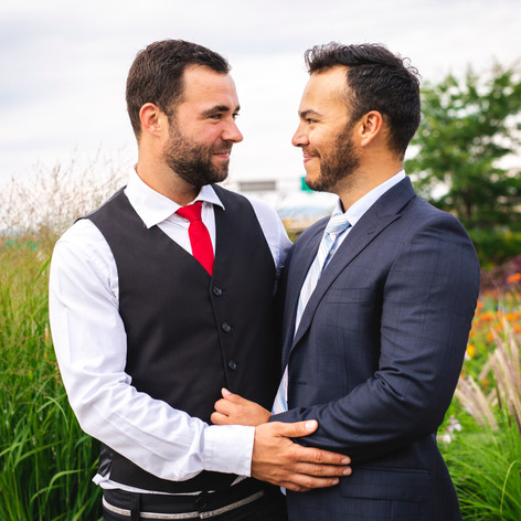 A Handsome gay male couple in the park o