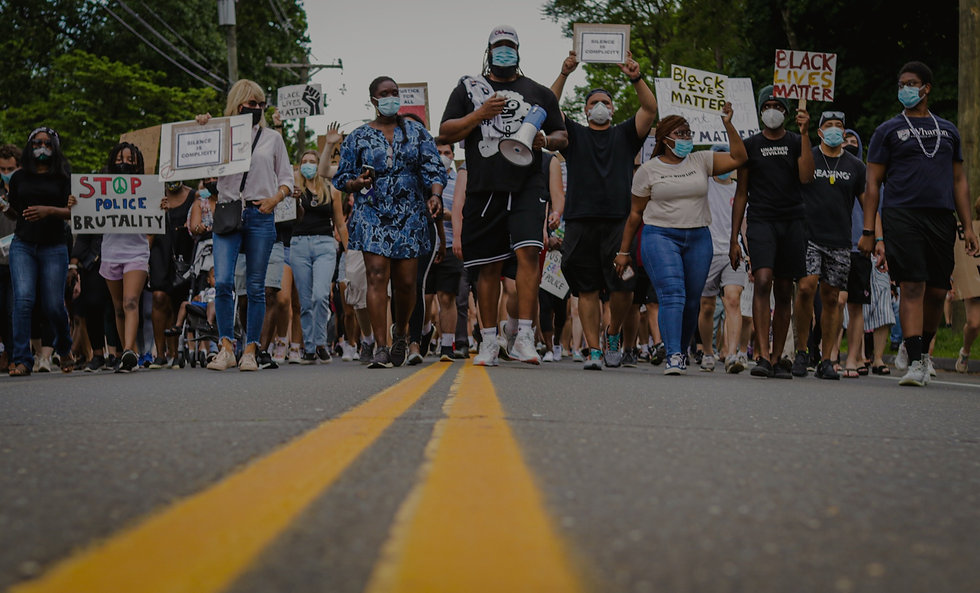 Group of people peacefully protesting the murder of George Floyd.