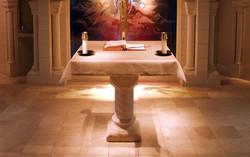 Altar, ambo, cathedra, and baptismal font