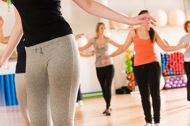 group of ladies in a fitness group class