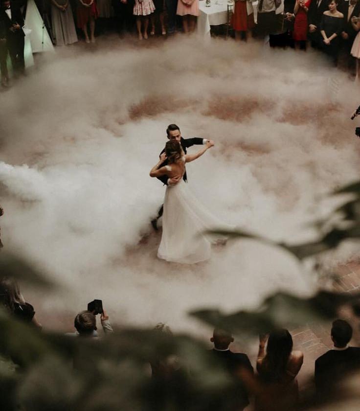 Wedding dance couple dancing in fog